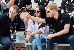 Prince Harry, right and his girlfriend Meghan Markle, centre, watch the wheelchair tennis competition at the Invictus Games in Toronto, ON, Canada, Monday September 25, 2017. This is Prince Harry's first public appearance with Markle. Photo by Nathan Denette/CP/ABACAPRESS.COM