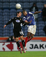 Photo: Lee Earle.<br /> Portsmouth v Wigan Athletic. The FA Cup. 06/01/2007. Wigan's Leighton Baines (L) and Glen Johnson battle in the air.