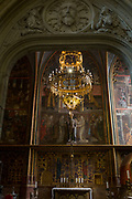 The Chapel Of St Wenceslas in St Vitas' Cathedral in Prague Castle, on 18th March, 2018, in Prague, the Czech Republic. The Metropolitan Cathedral of Saints Vitus, Wenceslaus and Adalbert is a Roman Catholic metropolitan cathedral in Prague, the seat of the Archbishop of Prague. Until 1997, the cathedral was dedicated only to Saint Vitus, and is still commonly named only as St. Vitus Cathedral. This cathedral is a prominent example of Gothic architecture and is the largest and most important church in the country. It is located within Hradcany-Prazsky Hrad (Prague Castle) in the Czech capital.