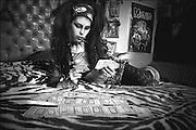 Guadalajara, Jalisco, México 2009. Isabel, en el interior de su habitación revisa el Tarot, tiene gran fe en sus poderes para predecir el futuro a través de la lectura de estas cartas. <br /> foto giorgio viera.