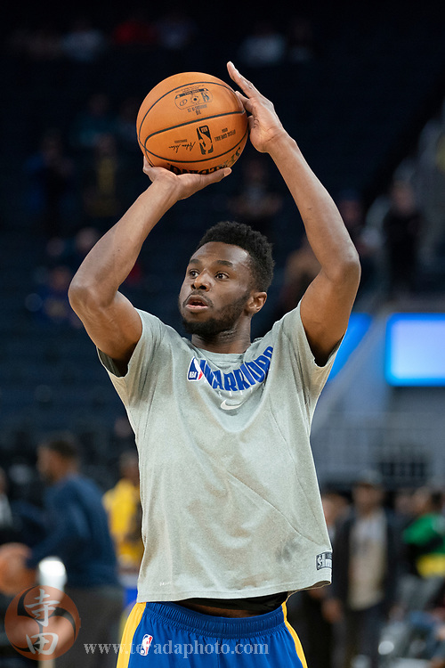 February 23, 2020; San Francisco, California, USA; Golden State Warriors guard Andrew Wiggins (22) warms up before the game against the New Orleans Pelicans at Chase Center.