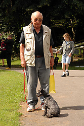 JOHN RITCHIE and his dog Dede at Macmillan Dog Day in aid of Macmillan Cancer Support, held at Royal Hospital Chelsea, London on 3rd July 2007.<br /><br />NON EXCLUSIVE - WORLD RIGHTS