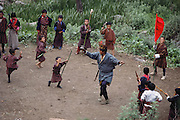 Dancing outside the Shingkhey Temple. As happens in every Bhutanese village each year, a two-day ceremony is held to bless the village of Shingkhey, Bhutan. From Peter Menzel's Material World Project.