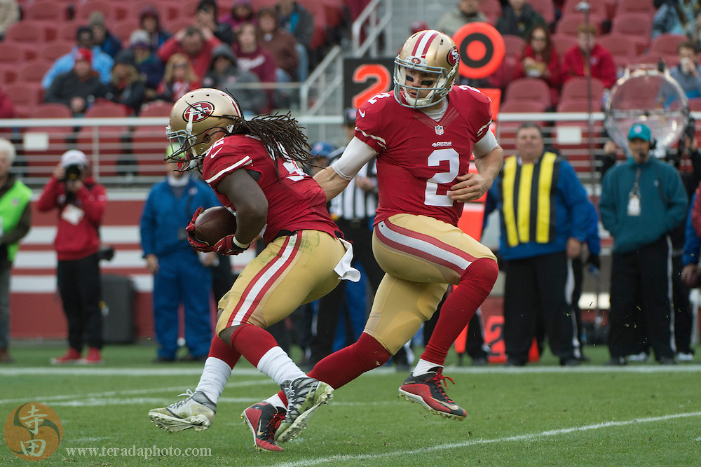 January 3, 2016; Santa Clara, CA, USA; San Francisco 49ers quarterback Blaine Gabbert (2) hands the football off to running back DuJuan Harris (32) against the St. Louis Rams during the third quarter at Levi's Stadium. The 49ers defeated the Rams 19-16.