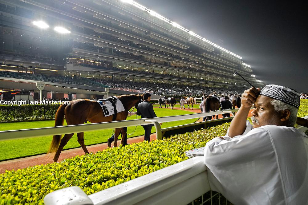 Horseracing meeting at Al Meydan rcecourse at night in Dubai United Arab Emirates