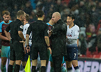 Football - 2018 / 2019 Premier League - Tottenham Hotspur vs. Burnley<br /> <br /> Sean Dyche, Manager of Burnley FC, shows his watch to Referee Graham Scott as he questions the referee about time added on at Wembley Stadium.<br /> <br /> COLORSPORT/DANIEL BEARHAM