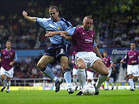 Photo. Glyn Thomas<br />West Ham Utd v Bradford City. Nationwide Division 1.<br />Upton Park, West Ham, London. 26/08/2003.<br />West Ham's Tomas Repka (R) holds off a challenge from Michael Branch.