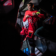 Leg 3, Cape Town to Melbourne, day 03,  Blair Take gets ready for watch on board MAPFRE. Photo by Jen Edney/Volvo Ocean Race. 12 December, 2017.