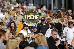 31 January 2016. New Orleans, Louisiana.<br /> Mardi Gras Dog Parade. The Treme Brass Band amongst the crowds with the Mystic Krewe of Barkus as the parade winds its way around the French Quarter with dogs and their owners dressed up for this year's theme, 'From the Doghouse to the Whitehouse.' <br /> Photo©; Charlie Varley/varleypix.com