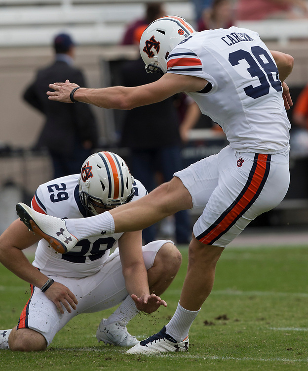 Auburn place kicker Daniel Carlson (38) warmups before the start of an NCAA college football game against Texas A&M on Saturday, Nov. 4, 2017, in College Station, Texas. (AP Photo/Sam Craft)