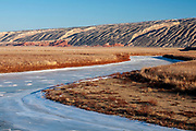 Bighorn River frozen in winter at the base of the Bighorn Mountains