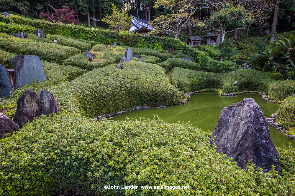 Rinshoji Garden, Rinshoji Temple is known for its unique modern Japanese garden, designed by renowned modern Japanese garden designer Mirei Shigemori.  Mirei fused modern art with Japanese garden design.  Here, he took advantage of the gentle hill and sculpted shrubs as part of the motif.  It follows a Japanese wave pattern, often used in kimono designs. The garden is especially alive during May when the azaleas are at their peak.