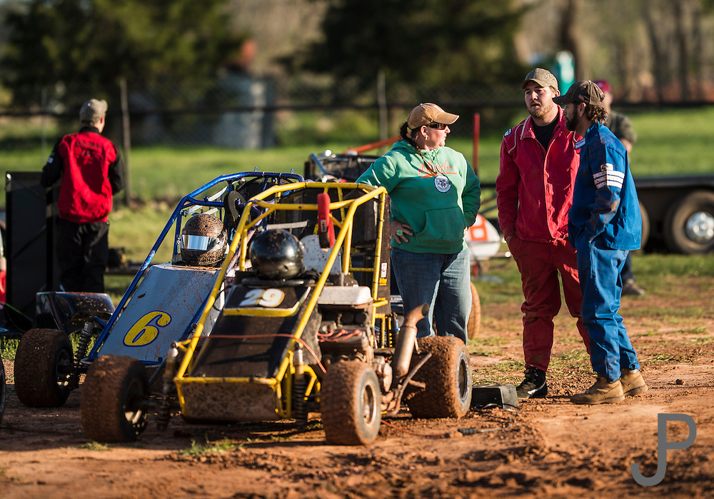 Grass roots racers talk about the track during a break in practice.