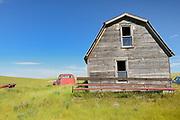 Old barn and truck on abandonned farm , Near Monchy, Saskatchewan, Canada