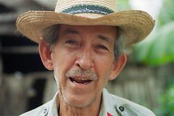 Portrait of a man wearing a straw hat; taken in Cuba on a cooperative farm near Pinar del Rio,