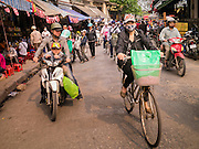 02 APRIL 2012 - HANOI, VIETNAM: Morning commuters ride their bicycles and motorcycles into Hanoi, the capital of Vietnam.    PHOTO BY JACK KURTZ