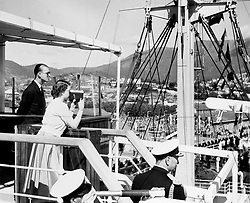 20/02/1954. The Duke of Edinburgh watches Queen Elizabeth II as she films the scene at Prince's Pier in Hobart, Tasmania. The Royal couple will celebrate their platinum wedding anniversary on November 20.