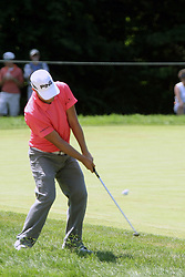 16 July 2006 Ryan Moore pops it out of the tall rough on the left side of #9.  He just missed the bunker and the green. The John Deere Classic is played at TPC at Deere Run in Silvis Illinois, just outside of the Quad Cities