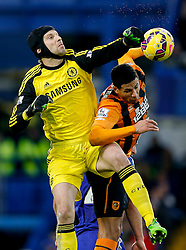 Petr Cech of Chelsea and Curtis Davies of Hull City compete in the air - Photo mandatory by-line: Rogan Thomson/JMP - 07966 386802 - 13/12/2014 - SPORT - FOOTBALL - London, England - Stamford Bridge - Chelsea v Hull City - Barclays Premier League.