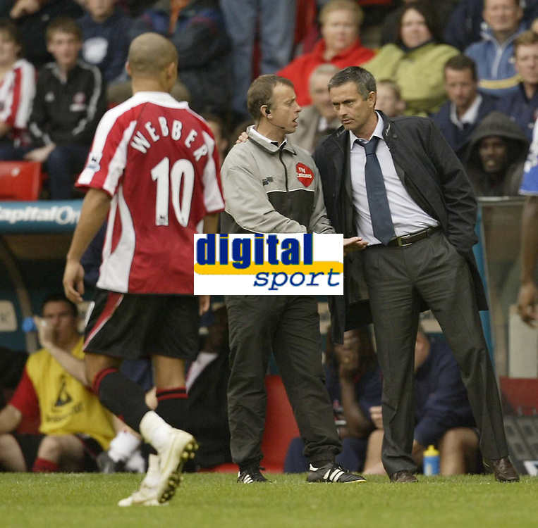 Photo: Aidan Ellis.<br /> Sheffield United v Chelsea. The Barclays Premiership. 28/10/2006.<br /> Chelsea's Jose Mourinho is told to calm down by the fourth official
