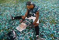 Philadelphia Eagles Jalen Mills sits on the field after the NFL Super Bowl 52 football game against the New England Patriots Sunday, Feb. 4, 2018, in Minneapolis. The Eagles won 41-33.<br /> <br />  (Tom DiPace via AP )