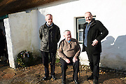28/03/2016  RnaG presenter (retired) Frainc a'mhaille from Ros Muc (seated)Pictured with Eoin Mac Lochlainn great grandnephews of Patrick Pearse at Pearse's Cottage, Teach an Phiarsaigh, in Rosmuc in Connemara during a special broadcast of RTÉ Raidió na Gaeltachta programme Adhmhaidin on Easter Monday 28 March 2016.  <br /> <br /> Patrick Pearse used the cottage as a summer house, and also as summer school for his pupils from St Enda's school in Dublin.  He was inspired by the people and the culture of the area, and it is said that he composed the graveside oration he gave at O'Donovan Rossa's funeral in 1915 there.<br /> <br /> The broadcast was to commemorate the centenary of the Easter Rising, and also marked 30 years on air for the programme.  <br /> Photo:Andrew Downes, xposure.