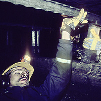 Norwegian coal miners work in a narrow seam deep underground in a mine on Spitsbergen Island, far north of the Arctic Circle.
