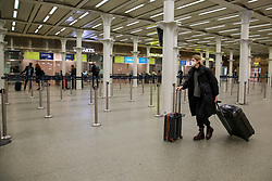 © Licensed to London News Pictures. 13/03/2020. London, UK. A woman wearing face mask at an empty St Pancras International departures amid an increased number of Coronavirus (COVID-19) cases in the UK. 798 cases have been tested positive and ten patients have died from the virus in the UK. Photo credit: Dinendra Haria/LNP