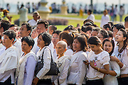 03 FEBRUARY 2013 - PHNOM PENH, CAMBODIA: Cambodians stand in line to get into the National Museum, site of former King Norodom Sihanouk's crematorium, to pay final respects to their former King. Sihanouk ruled Cambodia from independence in 1953 until he was overthrown by a military coup in 1970. The only music being played publicly is classical Khmer music. Sihanouk died in Beijing, China, in October 2012 and will be cremated during a state funeral royal ceremony on Monday, Feb. 4.     PHOTO BY JACK KURTZ