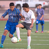 Gallup Bengal Derwin Ruiz (15) and Bloomfield Bobcat Isiah Natoni (14) fight for possession of the ball during the game held at Public School Stadium in Gallup Tuesday.