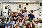 SMYRNA, TENN. - SEPT, 20: Richard Booher, 58, of Made City, Fla. poses for a portrait with his five children outside of their camper at I-24 Campground in Smyrna. Booher is working with the seasonal Amazon CampForce.<br /> <br /> (Photo by William DeShazer/For The Washington Post)