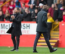 Aberdeen Derek McInnes looks away as Rangers manager Steven Gerrard walks past during the William Hill Scottish Cup quarter final match at Pittodrie Stadium, Aberdeen.