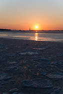 New York, the port of New York . the east river frozen and covered with ice in the distance the staue of Liberty.