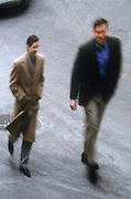 businessmen walking and talking in the street