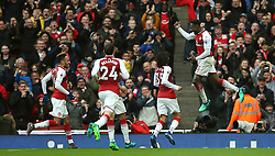 Arsenal's Danny Welbeck (right) celebrates after scoring his side's second goal of the game with team-mates