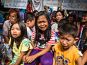 03 SEPTEMBER 2016 - BANGKOK, THAILAND: Children who live in the Pom Mahakan community cry while Bangkok city officials storm into the community to start evictions. Hundreds of people from the Pom Mahakan community and other communities in Bangkok barricaded themselves in the Pom Mahakan Fort to prevent Bangkok officials from tearing down the homes in the community Saturday. The city had issued eviction notices and said they would reclaim the land in the historic fort from the community. People prevented the city workers from getting into the fort. After negotiations with community leaders, Bangkok officials were allowed to tear down 12 homes that had either been abandoned or whose owners had agreed to move. The remaining 44 families who live in the fort have vowed to stay.      PHOTO BY JACK KURTZ