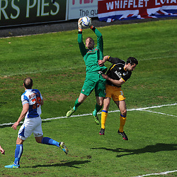 Bristol Rovers' Steve Mildenhall collects a high ball from Mansfield Town's Paul Black - Photo mandatory by-line: Alex James/JMP - Mobile: 07966 386802 03/05/2014 - SPORT - FOOTBALL - Bristol - Memorial Stadium - Bristol Rovers v Mansfield - Sky Bet League Two