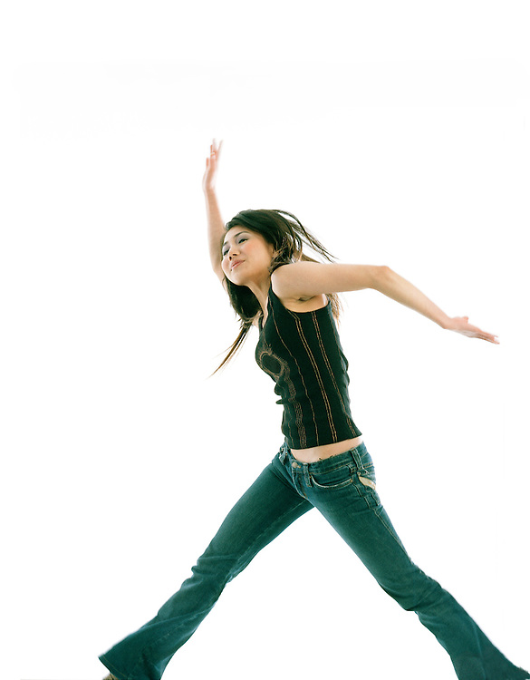 Fashionable  portrait of an asian woman jumping