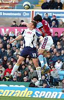 Photo: Ed Godden.<br />Aston Villa v Portsmouth. The Barclays Premiership. 04/03/2006. <br />Sean Davis (L) and Villa's Liam Ridgewell clash in the air.