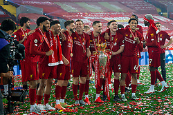 LIVERPOOL, ENGLAND - Wednesday, July 22, 2020: Liverpool's Joe Gomez, Alex Oxlade-Chamberlain, Adam Lallana, James Milner, captain Jordan Henderson, Andy Robertson and Trent Alexander-Arnold celebrate with the Premier League trophy and their winners' medal as the Reds are crowned Champions after the FA Premier League match between Liverpool FC and Chelsea FC at Anfield. The game was played behind closed doors due to the UK government's social distancing laws during the Coronavirus COVID-19 Pandemic. Liverpool won 5-3. (Pic by David Rawcliffe/Propaganda)