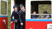 "The Childrens Railway <br /> <br /> In the outskirts of Budapest, through the scenic Buda hills, run a short, narrow-gauge railway line called Gyermekvasút, which is Hungarian for ""Children's Railway"". But Gyermekvasút is not a toy train commonly found in amusement parks. It's a real railway line with real stations, real diesel locomotives pulling real coaches, and running on a real schedule. The ""Children"" here are not the passengers. They are the railway workers.<br /> <br /> The Children's Railway is staffed and run mostly by pre-adolescent kids aged between 10 to 14, under adult supervision, of course. Only the driving and maintenance stuff are done by adults. All other jobs, from checking and issuing tickets, operating signals, making announcements and giving information to passengers, are performed by young people dressed in immaculate official uniforms complete with all the appropriate paraphernalia.<br /> The Children's Railway is a relic of the communist era, built at a time when the Young Pioneers movement was in full force. The Young Pioneers was a youth movement of the Communist Party, similar to the Scouts movement of the Western world, where young people learned skills of social cooperation and attended publicly funded summer camps. The early Young Pioneers were originally Scouts who took the Bolsheviks' side after the October Revolution of 1917. Many Scouts, however, resisted the communists and fought in the ranks of the White Army and interventionists against the Red Army during the Russian Civil War of 1917-1921. After communism got a firm hold over the country, the Scouting system was eradicated and replaced by the ideologically different Young Pioneer organization to properly educate children with Communist teachings.<br /> The Children's Railway, sometimes also called the Pioneer Railway, was a project of the Young Pioneers where teenagers and children learned the railway profession. They were established all across the Russian Union and Eastern Europe where communism h"