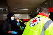 A Red Cross worker is seen helping unload a meat delivery at the Alfred Street housing commission tower during COVID-19 on 10 July, 2020 in Melbourne, Australia. Former Federal Labor Leader Bill Shorten, along with close allies at Trades Hall help deliver Halal meat, supplied by Macca Halal Foods to the locked down housing commission towers following a coronavirus outbreak detected inside the complex. Mr Shorten was able to use his high profile to ensure food was not turned away by police so that it would reach the residents inside. (Photo be Dave Hewison/ Speed Media)
