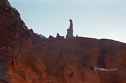 Naked man on a rock ledge in Utah