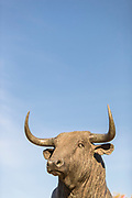 Bronze bull statue against blue sky, Ronda, Andalusia, Spain