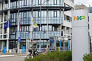 Nederland, Nijmegen, 26-2-2020 NXP semiconductors. Fabriek. Hoofdingang van de vestiging . Er worden chips, halfgeleiders, gemaakt. Het bedrijf adviseert werknemers die ziek zijn of onlangs in china waren thuis te blijven vanwege het corona virus . Foto: Flip Franssen