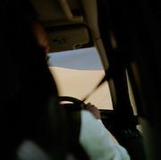 View from inside a 4x4 vehicle driving in the Sahara desert, Libya