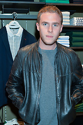 IAIN DE CAESTECKER at a party to celebrate the reopening of the Lacoste Premium Store at 233 Regent Street, London on 28th May 2014.