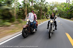 Bill Grotto of Twisted Tea riding his personal Panhead alongside Kissa Von Adams on her custom chopper through Tomoka State Park during Daytona Bike Week. FL. USA. Sunday March 18, 2018. Photography ©2018 Michael Lichter.
