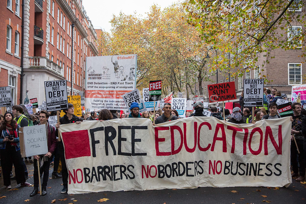 Thousands of students assemble behind a banner for a National Demonstration for a Free Education on 4th November 2015 in London, United Kingdom. The demonstration was organised by the National Campaign Against Fees and Cuts NCAFC in protest against tuition fees and the Government's plans to axe maintenance grants with effect from 2016.
