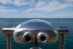 Detail of public coin operated binoculars by seaside
